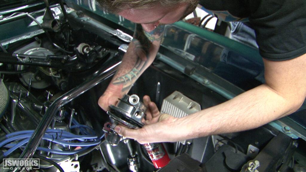 Jason Schneider installs a 1969 Mustang fuel pump.